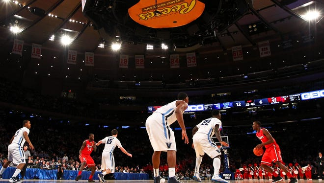 """The Big East Conference tournament will remain at Madison Square Garden with the seven schools in the """"new"""" Big East."""