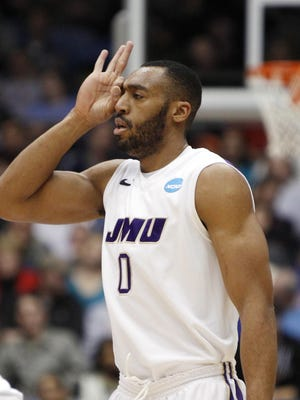 James Madison guard A.J. Davis signals to the bench after making a three-point shot against the Long Island Blackbirds in the second half during the first round of the 2013 NCAA tournament at University of Dayton Arena. James Madison defeated LIU Brooklyn 68-55.