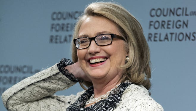 Former secretary of State Hillary Rodham Clinton smiles before speaking on American leadership at the Council on Foreign Relations.