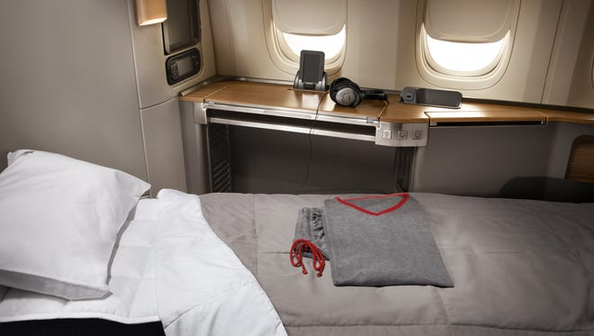 First-class passengers flying on American Airlines' 777-300ER are treated to turn-down service and a set of pajamas.