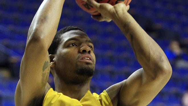 North Carolina A&T forward Adrian Powell shoots during practice on Wednesday in Lexington, Ky.