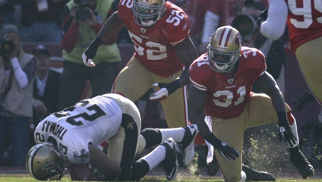 Saints RB Pierre Thomas (23) was lost in a 2011 playoff game after he lowered his helmet and absorbed a head-to-head blow from 49ers S Donte Whitner (31).