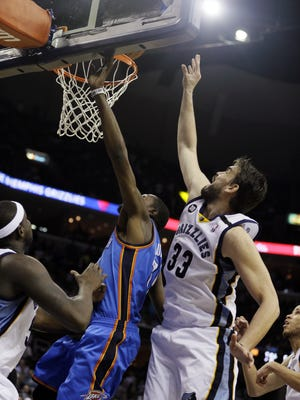Grizzlies center Marc Gasol tips the ball over Thunder forward Kevin Durant to end overtime in Wednesday's 90-89 win.