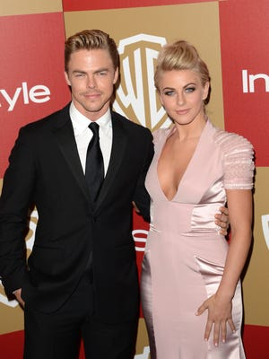 Derek Hough and Julianne Hough at the Oasis Courtyard at the Beverly Hilton Hotel on Jan. 13.