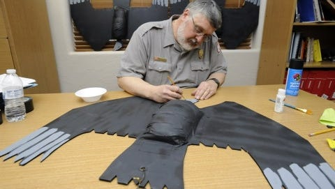 Bruce Caldwell, supervisory natural resource biologist with the U.S. Army Corps of Engineers, paints a vulture effigy on Monday, March 18, 2013. Personnel at the Bull Shoals Dam and Powerhouse have been battling a huge flock of vultures which have been roosting on the dam and causing significant damage. The vulture effigies are the latest attempt at dispersing the birds. (Gannett, Kevin Pieper/The (Mountain Home, Ark.) Baxter Bulletin)