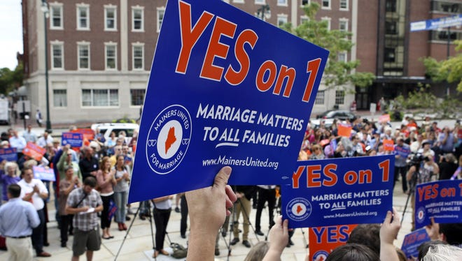 Gay marriage supporters rally in Portland, Maine, on Sept. 10, 2012, in favor of a ballot question legalizing same-sex marriages. The measure would pass in November.