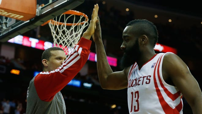 Rockets guard James Harden, right, high-fives guard Francisco Garcia after Wednesday's win against the Jazz.