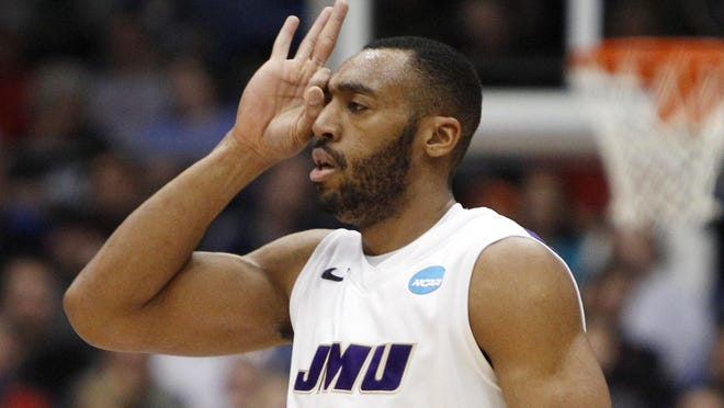 James Madison guard A.J. Davis (0) signals to the bench after making a three-point shot against LIU Brooklyn in the first round of the 2013 NCAA tournament at University of Dayton Arena. James Madison defeated LIU Brooklyn 68-55 to advance to a second-round game against top seed Indiana.