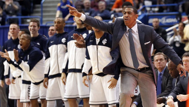 Connecticut Huskies head coach Kevin Ollie watches from the sideline as they his team takes on the Syracuse Orange during the second half at the XL Center.