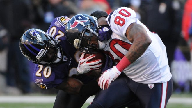 Changing colors: Ed Reed (20) will swap Ravens purple for Texans blue this season while reuniting with college teammate Andre Johnson (80).