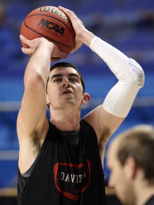 Davidson Wildcats forward Jake Cohen (15) shoots the ball during practice the day before the second round of the 2013 NCAA tournament at Rupp Arena.