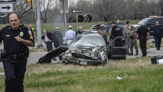 The driver of this black Cadillac with Colorado plates crashed Thursday afternoon in Decatur, Texas, after a chase and shootout with law enforcement. The unidentified suspect was shot in the head and is brain dead in a Fort Worth hospital. Authorities are investigating whether he was involved in  the Tuesday night murder of Colorado's prisons chief.