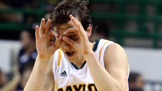Baylor's Brady Heslip reacts to a 3-point shot against Long Beach State during the first half of an NIT first-round college basketball game in Waco, Texas.