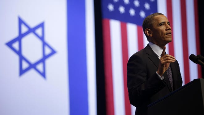 President Obama gestures during his speech at the Jerusalem Convention Center on Thursday.