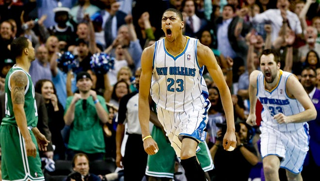 Hornets forward Anthony Davis screams after his game-winning tip Wednesday against the Celtics.