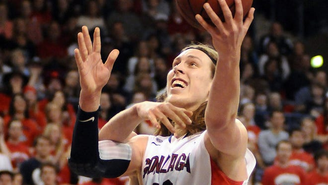Gonzaga Bulldogs forward Kelly Olynyk makes a basket against Portland Pilots center Thomas van der Mars during the first half at the McCarthey Athletic Center.