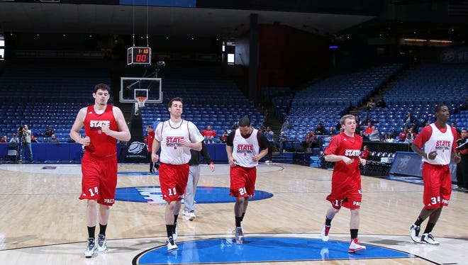 North Carolina State Wolfpack run in practice the day before the second round of the 2013 NCAA tournament at University of Dayton Arena.