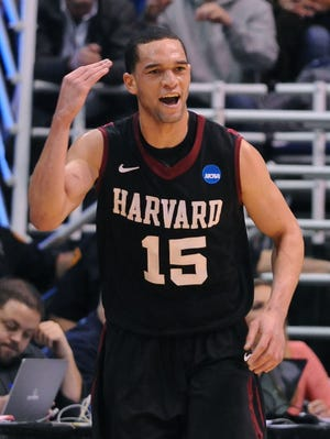 Harvard Crimson guard Christian Webster (15) celebrates after hitting a three point shot in the first half of the game against the New Mexico Lobos during the second round of the 2013 NCAA tournament at EnergySolutions Arena.