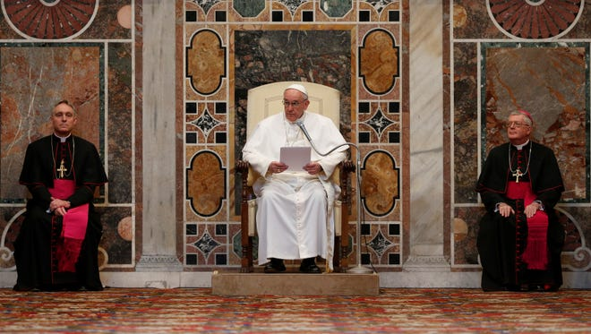 Pope Francis delivers his message during an audience with the diplomatic corps at the Vatican on Friday.