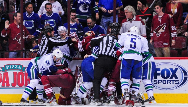 A melee breaks out Thursday night after Vancouver's Alex Edler ran over Phoenix goalie Mike Smith.