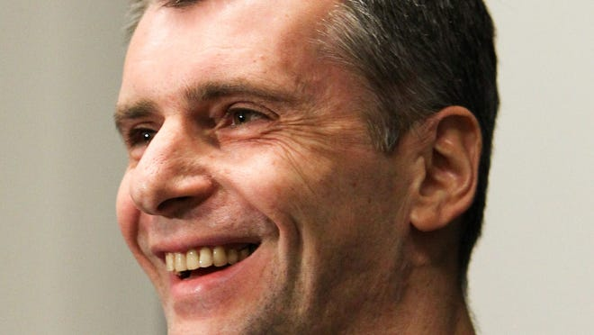 Brooklyn Nets owner Mikhail Prokhorov says he's happy for his team getting into he playoffs. But is he really?