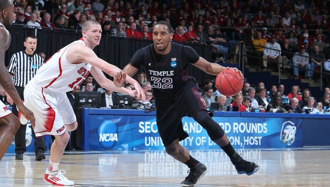 Temple forward Rahlir Hollis-Jefferson is guarded by North Carolina State forward Scott Wood during their second round of the NCAA tournament.