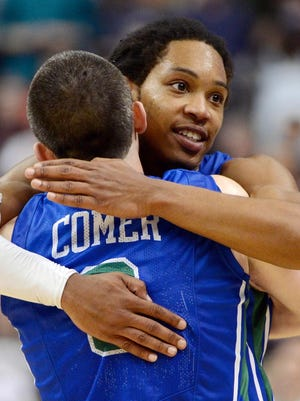 Florida Gulf Coast guard Sherwood Brown (25) and guard Brett Comer (0) celebrate a 78-68 win against Georgetown in the second round of the NCAA tournament at the Wells Fargo Center in Philadelphia on March 22.