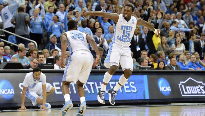 North Carolina Tar Heels guard P.J. Hairston (15) celebrates after a score with teammate Reggie Bullock (35) against the Villanova Wildcats in the second half during the second round of the 2013 NCAA tournament at the Sprint Center.
