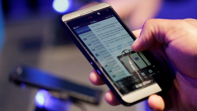A person tries out a BlackBerry Z10 in New York when it was announced Jan. 30.