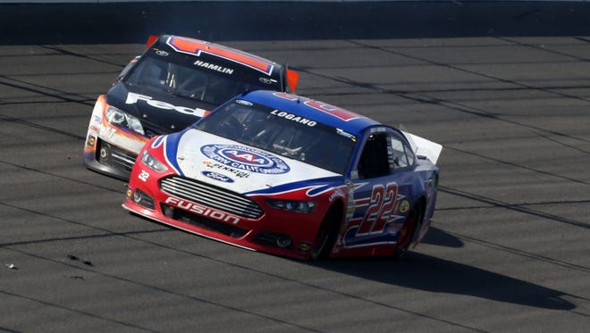 Joey Logano (22) collides with Denny Hamlin (11) on the final lap of Sunday's Auto Club 500 in Fontana, Calif.