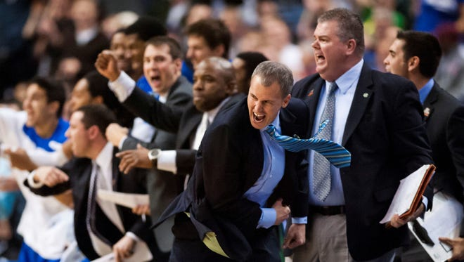 Florida Gulf Coast Eagles head coach Andy Enfield reacts to a basket late in the second half against the San Diego State Aztecs during the third round of the NCAA basketball tournament at Wells Fargo Center. Florida Gulf Coast defeated San Diego State 81-71.