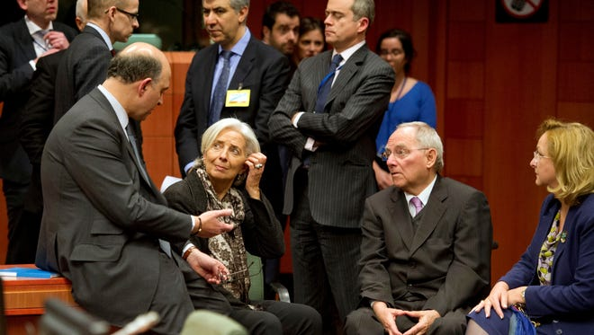 From front left, French Finance Minister Pierre Moscovici, Managing Director of the International Monetary Fund Christine Lagarde, German Finance Minister Wolfgang Schaeuble and Austria's Finance Minister Maria Fekter speak with each other during an emergency eurogroup meeting in Brussels on Sunday.