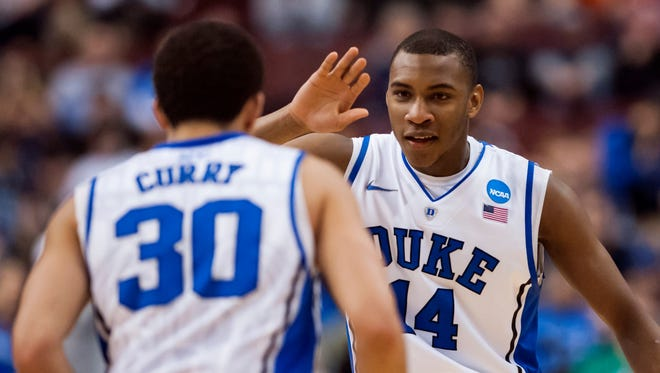 Midwest Regional (Philadelphia): Duke Blue Devils guard Rasheed Sulaimon celebrates with guard Seth Curry during the second half against the Creighton Bluejays at Wells Fargo Center. Sulaimon led the Blue Devils with 21 points in the 66-50 win.