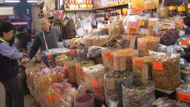 Sacks of dried seafood -- such as sea cucumbers, fish, shrimp, fish bladder -- as well as nuts are for sale in the Fa Yuen Street market.