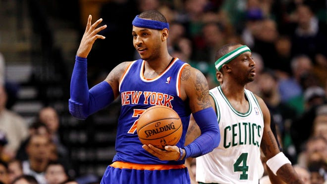 New York Knicks small forward Carmelo Anthony (7) reacts during the second half of a game against the Boston Celtics at TD Garden.