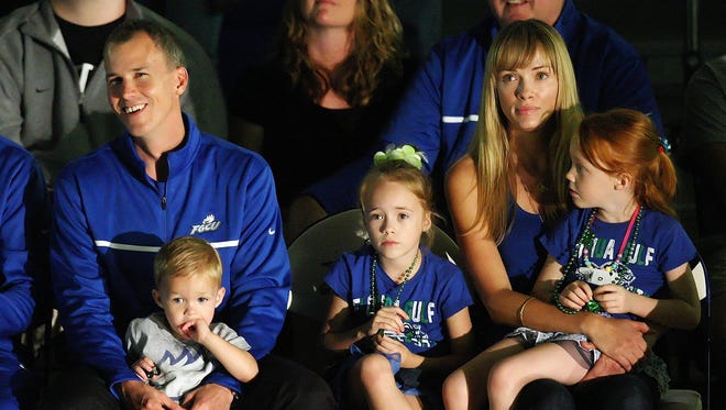 FGCU head coach Andy Enfield sits with his family, including wife Amanda Marcum, during the team's Selection Sunday event.