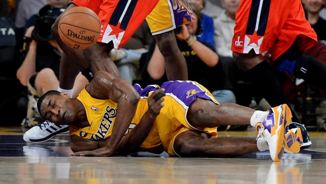 Los Angeles Lakers small forward Metta World Peace (15) goes for a loose ball during the first half of the game against the Washington Wizards at the Staples Center.