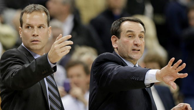 Duke assistant  Chris Collins, left, gestures in a Jan. 30 game this  season with Duke coach Mike Krzyzewski, right.