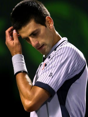 The world's top-ranked player, Novak Djokovic, wipes his forehead between points while playing Tommy Haas during the Sony Open. Haas upset Djokovic, 6-2, 6-4.