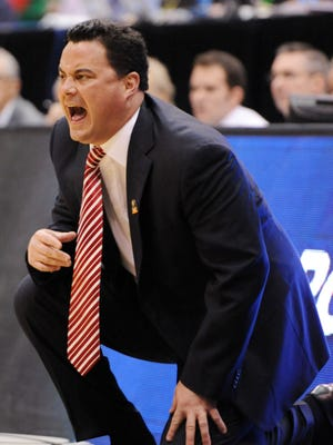 Arizona coach Sean Miller yells out to his team in the first half of the game against Harvard during the third round of the NCAA basketball tournament.