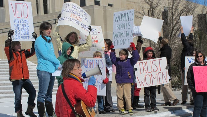 Kris Kitko leads chants of protest at an abortion rights rally at the state Capitol in Bismarck, N.D., on March 25.