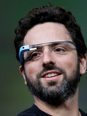 Google co-founder Sergey Brin demonstrates Google's new Glass last summer in San Francisco.