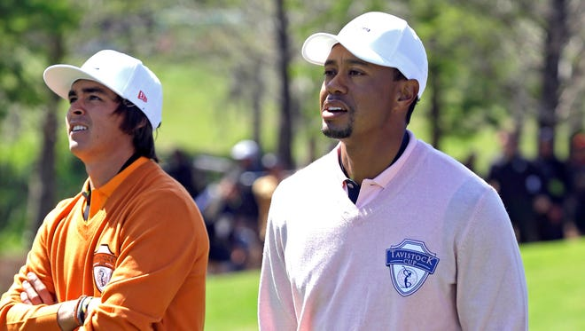 Rickie Fowler, left, and Tiger Woods walk down the fourth fairway during the Tavistock Cup on Tuesday.