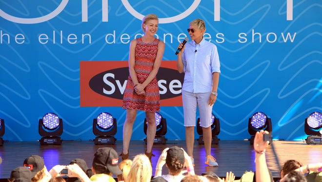 Ellen DeGeneres introduces Portia de Rossi in Melbourne on Tuesday at Birrarung Marr Park.