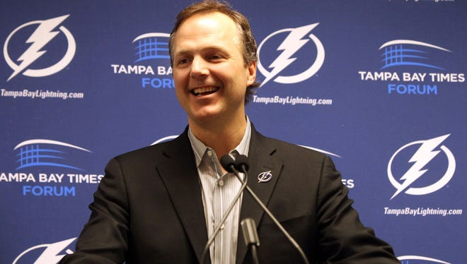 Tampa Bay Lightning coach Jon Cooper is introduced at a news conference on Tuesday.