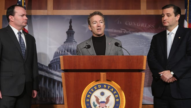 Sen. Rand Paul, R-Ky., center, is joined by Sen. Mike Lee, R-Utah, left, and Sen. Ted Cruz, R-Texas, right, at a Capitol Hill news conference.