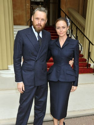 Stella McCartney and her husband, Alasdhair Willis,   arrive at Buckingham Palace for an Investiture Ceremony.