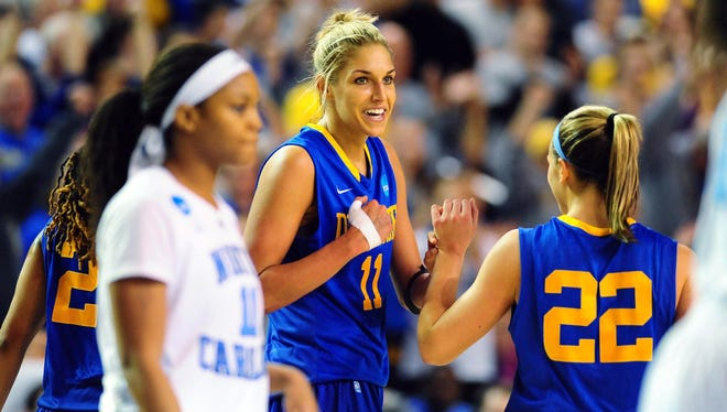 Delaware Blue Hens forward Elena Delle Donne celebrates with guard Lauren Carra after beating the North Carolina Tar Heels at the Bob Carpenter Center.