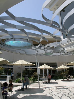 The Bookmark Cafe at the Santa Monica Library has umbrella-shaded tables around a desert garden and river design.