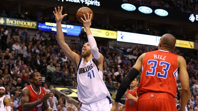 Dallas Mavericks forward Dirk Nowitzki (41) shoots against Los Angeles Clippers guard Eric Bledsoe (12) at the American Airlines Center.